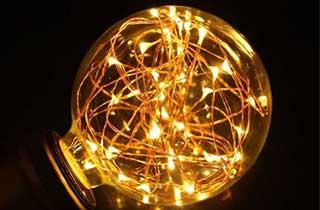 bombilla fairy bulb light encendida en color cálido
